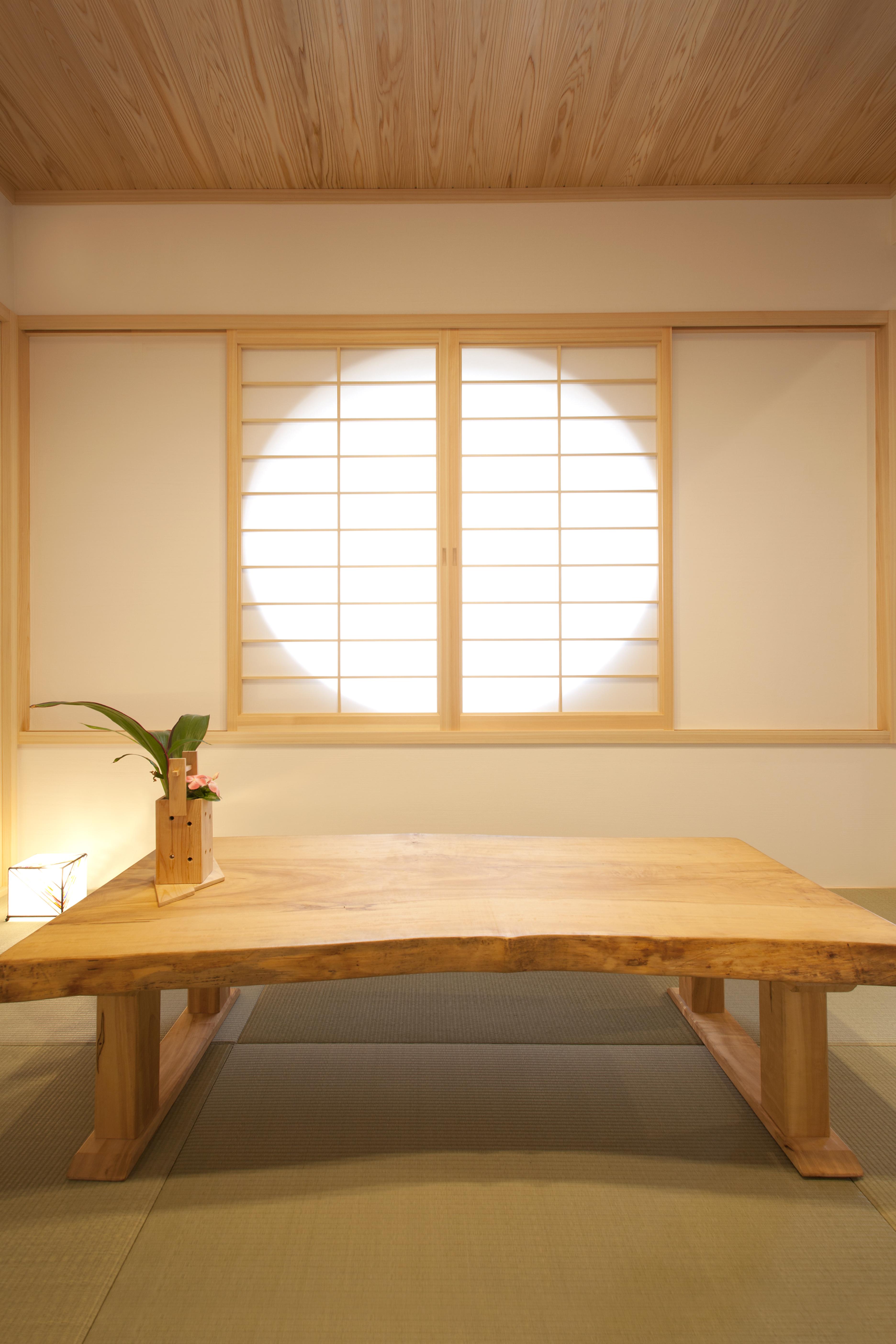 丸窓の「光冷暖の家」